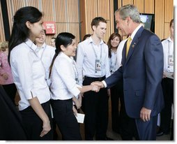 President George W. Bush greets APEC staff outside the Concert Hall at the Sydney Opera House Friday, Sept. 7, 2007, after addressing the APEC Business Summit. White House photo by Eric Draper