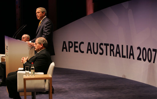 President George W. Bush speaks to the APEC Business Summit Friday, Sept. 7, 2007, at the Sydney Opera House. Joining him on stage are Australia's Prime Minister John Howard, far left, and Mark Johnson, Chairman of the APEC Business Advisory Council. White House photo by Chris Greenberg