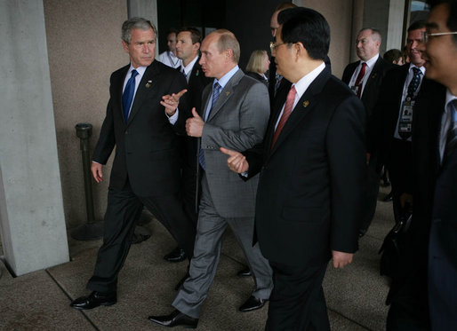President George W. Bush, President Vladimir Putin of Russia, and President Hu Jintao of the People's Republic of China, gesture as they walk to the APEC Leaders Retreat Saturday, Sept. 8, 2007, at the Sydney Opera House. White House photo by Eric Draper