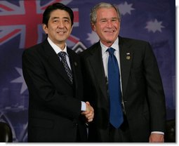 "President George W. Bush and Prime Minister Shinzo Abe of Japan, shake hands following their meeting Saturday, Sept. 8, 2007, in Sydney. The President thanked the Prime Minister for his support in the war on terrorism, saying, ""The fact that we're in a war against extremists was heightened today by the release of a tape. The tape is a reminder about the dangerous world in which we live, and it is a reminder that we must work together to protect our people against these extremists."" White House photo by Eric Draper"