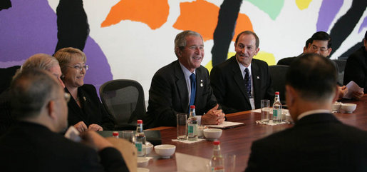 President George W. Bush smiles as he joins fellow APEC leaders during a dialogue Saturday, Sept. 8, 2007, with members of the APEC Business Advisory Council at the Sydney Opera House in Sydney, Australia. White House photo by Eric Draper