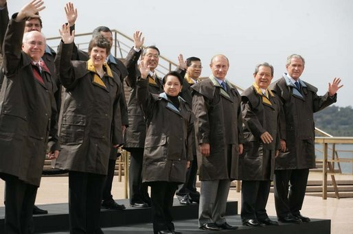 President George W. Bush and fellow APEC leaders don brown Drizabone coats as they pose for the official APEC portrait Saturday, Sept. 8, 2007, at the Sydney Opera House. White House photo by Eric Draper