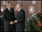 President George W. Bush is welcomed to the Asian-Pacific Economic Cooperation summit in Sydney by Australia's Prime Minister John Howard Saturday, Sept. 8, 2007, at the Sydney Opera House. White House photo by Chris Greenberg