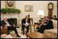 President George W. Bush, joined by Vice President Dick Cheney, meets with Health and Human Services Secretary Michael O. Leavitt in the Oval Office, Monday, Sept. 10, 2007, to talk about the Interagency Working Group on Import Safety's initial report and the group's next steps in enhancing the safety of imported products. White House photo by Joyce N. Boghosian