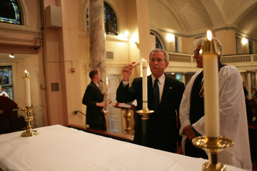 As Reverend Luis León looks on, President George W. Bush lights a candle during a service of prayer and remembrance at St. John's Episcopal Church in Washington, D.C., Tuesday, Sept.11, 2007, marking the sixth anniversary of the Sept. 11, 2001 terrorist attacks on U.S. soil. White House photo by Eric Draper