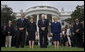 President George W. Bush, Mrs. Laura Bush, Vice President Dick Cheney and Mrs. Lynne Cheney bow their heads for a moment of silence on the South Lawn of the White House Tuesday, Sept. 11, 2007, in memory of those whose lives were lost on Sept. 11, 2001. White House photo by Chris Greenberg