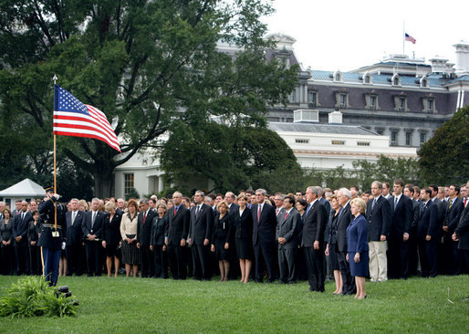 President George W. Bush and Mrs. Laura Bush are joined by Vice President Dick Cheney and Mrs. Lynne Cheney Tuesday, Sept. 11, 2007, on the South Lawn of the White House for a moment of silence in memory of those who died Sept. 11, 2001. White House photo by David Bohrer