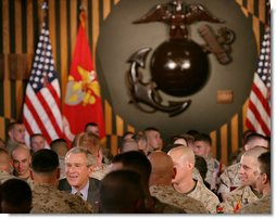 President George W. Bush talks with U.S. Marines during his lunch visit to The Basic School at Quantico Marine Corps Base Friday, Sept.14, 2007 in Quantico, Va. White House photo by Chris Greenberg
