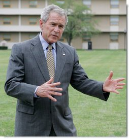 President George W. Bush gestures as he talks with members of the media following his lunch with U.S. Marines during his visit to The Basic School at Quantico Marine Corps Base Friday, Sept.14, 2007 in Quantico, Va. White House photo by Chris Greenberg