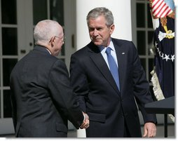 President George W. Bush shakes the hand of Judge Michael Mukasey after announcing his nomination to be U.S. Attorney General Monday, Sept. 17, 2007, in the Rose Garden. White House photo by Eric Draper