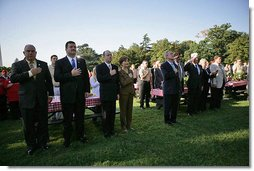 President George W. Bush and Laura Bush stand for the singing of the national anthem during a visit with military support organizations Tuesday, Sept. 18, 2007, on the South Lawn. White House photo by Eric Draper