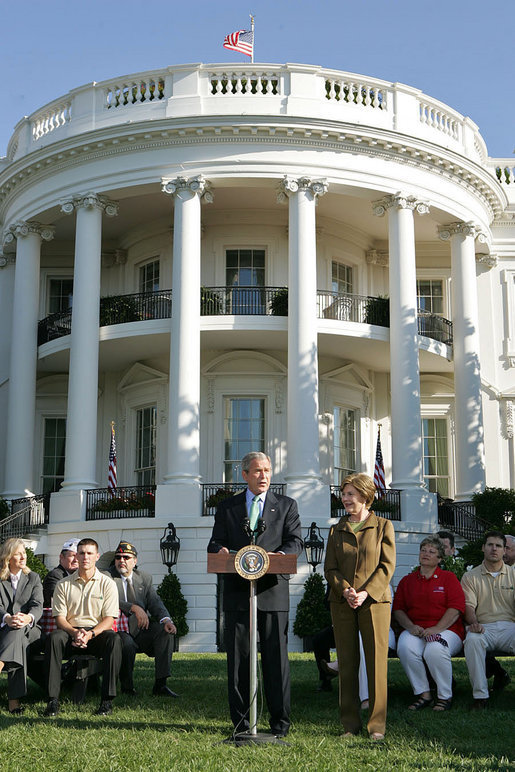 "Standing with Mrs. Laura Bush, President George W. Bush addresses military support organizations Tuesday, Sept. 18, 2007, on the South Lawn. ""I feel a very strong obligation, since it was my decision that committed young men and women into combat, to make sure our veterans who are coming back from Iraq and Afghanistan get all the help this government can possibly provide,"" said President Bush. White House photo by Chris Greenberg"