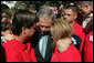 President George W. Bush consoles Ronald Klopf and Lisa West-Klopf, both of Aguanga, Calif., during a gathering of military support organizations Tuesday, Sept. 18, 2007, on the South Lawn. Their son, Lance Cpl. Jeromy West, was killed November of 2006 while serving with the U.S. Marines in Iraq. White House photo by Chris Greenberg