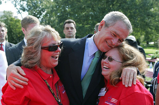 President George W. Bush hugs Theresa Luna of Oxnard, Calif., left, and Debbie Parrish of LaSalle, Colo., during an event for military support organizations Tuesday, Sept. 18, 2007, on the South Lawn. Ms. Luna's son, Pfc. Kevin Luna, died in June 2005 while serving with the U.S. Army in Iraq. Ms. Parrish's son, Pfc. Victor Parrish, is serving with the U.S. Marines in Iraq. White House photo by Chris Greenberg