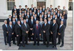 President George W. Bush stands with members of Johns Hopkins University Men's Lacrosse Championship Team Friday, Sept. 21, 2007, at the White House during a photo opportunity with the 2006 and 2007 NCAA Sports Champions. White House photo by Eric Draper
