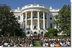 "President George W. Bush addresses the NCAA 2006 and 2007 championship Teams during a ceremony Friday, Sept. 21, 2007, on the South Lawn. ""Because you're a champ on the field, you have a chance to inspire somebody to make right choices in life,"" said President Bush in his remarks. ""You have the opportunity to set a good example. You don't know how many youngsters are looking at you, but there's a lot. People are wondering how champs behave. So by setting high standards and working hard to achieve them, you're influencing other people."" White House photo by Chris Greenberg"