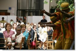 Mrs. Laura Bush listens to the African Children's Choir during a luncheon on global health and literacy Tuesday, Sept. 24, 2007, at the Pierpont Morgan Library in New York. White House photo by Shealah Craighead