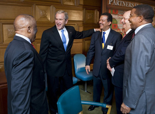 President George W. Bush pauses with fellow heads of state following a Roundtable on Democracy Tuesday, Sept. 25, 2007, at the United Nations in New York. From left are: President Festus Gontebanye Mogae of the Republic of Botswana; President Bush; President Leonel Fernandez of the Dominican Republic; Secretary of State for Foreign Relations Carlos Morales Troncoso of the Dominican Republic, and President Jakaya Kikwete of the United Republic of Tanzania. White House photo by Eric Draper