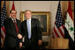 "President George W. Bush and Prime Minister Nouri Al-Maliki of Iraq, shake hands after their meeting Tuesday, Sept. 25, 2007, at the Waldorf-Astoria Hotel in New York City. The President told his Iraq counterpart, "".We're with you, Prime Minister. We thank you for the courage of the Iraqi people."" White House photo by Eric Draper"