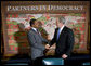 President George W. Bush shakes hands with Tanzania President Jakaya Kikwete during their participation in a Roundtable on Democracy Tuesday, Sept. 25, 2007, at the United Nations in New York. White House photo by Eric Draper