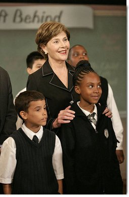 Mrs. Laura Bush stands with students from New York Public School 76 during the President's statement regarding No Child Left Behind Wednesday, Sept. 26, 2007, in New York. White House photo by Eric Draper