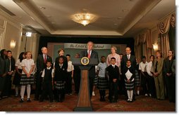 "President George W. Bush discusses the reauthorization of No Child Left Behind Wednesday, Sept. 26, 2007, in New York. Those standing with President Bush include New York Mayor Michael Bloomberg, far left, Mrs. Laura Bush and students from New York Public School 76. ""The No Child Left Behind Act is working. I say that because the Nation's Report Card says it's working,"" said President Bush. ""Scores are improving, in some instances hitting all-time highs."" White House photo by Shealah Craighead"