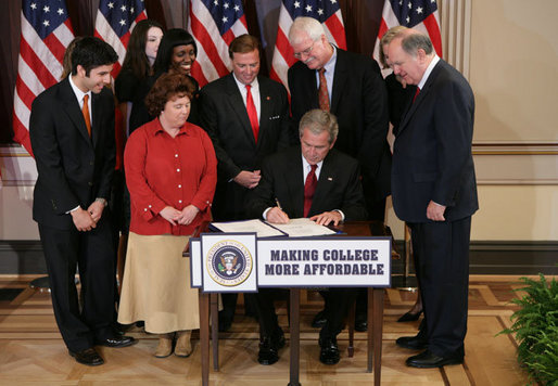 President George W. Bush signs H.R. 2669, the College Cost Reduction and Access Act, Thursday, September 27, 2007, in the Dwight D. Eisenhower Executive Office Building in Washington, D.C. The President is joined by Robert Garcia, a junior at the University of Texas, Laura Tappan, a sophomore at Northern Virginia Community College, Kalise Robinson, a junior at the University of the District of Columbia, Margie Clark, a student at Lord Fairfax Community College, Congressman Ric Keller of Florida, Congressman George Miller of California, Congressman John Spratt of South Carolina, and Secretary of Education Margaret Spellings. White House photo by Chris Greenberg