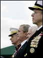 President George W. Bush attends an Armed Forces farewell tribute in honor of U.S. Marine General Peter Pace, left, and Armed Forces hail in honor of Navy Admiral Michael Mullen, right, joined by Secretary of Defense Robert Gates, Monday, October 1, 2007 at Fort Myer, Va. General Pace is retiring after serving two years as Chairman and four years as Vice Chairman of the Joint Chiefs of Staff. White House photo by Eric Draper