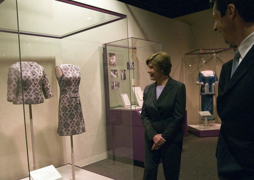 Mrs. Laura Bush looks at a dress worn by Jacqueline Kennedy during a tour of the exhibit First Ladies: Political Role and Public Image at the National Constitution Center Monday, Oct. 1, 2007, in Philadelphia. White House photo by Shealah Craighead