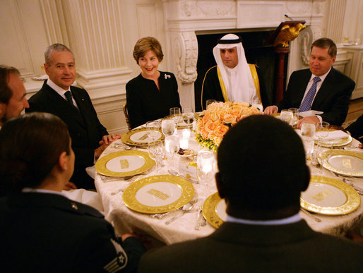 Mrs. Laura Bush speaks with guests at her table during the Iftaar Dinner with Ambassadors and Muslim leaders in the State Dining Room of the White House, Thursday, Oct. 4, 2007. White House photo by Chris Greenberg