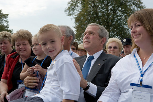 President George Bush holds 8-year-old Turner Koyle of Holden, Utah, during a ceremony at the National Fallen Firefighters Memorial in Emmitsburg, Md., Sunday, Oct. 7, 2007. White House photo by Chris Greenberg