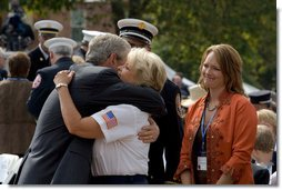 President George Bush greets and offers comfort to friends and family of fallen firefighters during a ceremony at the National Fallen Firefighters Memorial service in Emmitsburg, Md., Sunday, Oct. 7, 2007. White House photo by Chris Greenberg