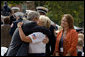 President George Bush greets and offers comfort to friends and family of fallen firefighters during a ceremony at the National Fallen Firefighters Memorial in Emmitsburg, Md., Sunday, Oct. 7, 2007. White House photo by Chris Greenberg