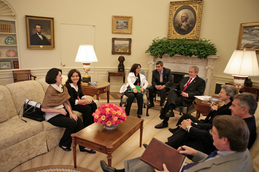 President George W. Bush meets with Yamile Llanes Labrada and her daughter Shirln Garcia, pictured sitting immediately to her mother's right, Wednesday, Oct. 10, 2007, in the Oval Office. Mrs. Labrada is the wife of Cuban political prisoner Dr. Jose Luis Garcia Paneque. White House photo by Eric Draper