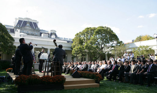 President George W. Bush and guests enjoy the entertainment of Cachao and his band during a Rose Garden celebration Wednesday, Oct. 10, 2007, of Hispanic Heritage Month. White House photo by Chris Greenberg