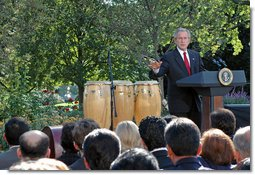 "President George W. Bush delivers remarks during a celebration of Hispanic Heritage Month Wednesday, Oct. 10, 2007, in the Rose Garden. ""Hispanic Americans strengthen our nation with their commitments to familia y fe (family and faith),"" said the President. ""Hispanic Americans enrich our country with their talents and creativity and hard work. Hispanic Americans are living the dream that has drawn millions to our shores -- and we must ensure that the American Dream remains available for all."" White House photo by Grant Miller"