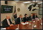 "President George W. Bush meets with his economic advisors Thursday, Oct. 11, 2007, in the New Executive Office Building in Washington, D.C. ""The deficit today is at 1.2 percent of GDP, which is lower than the average of the last 40 years. In other words, we have told the American people that by keeping taxes low we can grow the economy, and by working with Congress to set priorities we can be fiscally responsible and we can head toward balance,"" said President Bush in a statement to the press. ""And that's exactly where we're headed."" White House photo by Chris Greenberg"