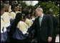 President George W. Bush meets with members of the Ballou High School Marching Band of Washington, D.C., following a photo with the band on the South Portico of the White House Thursday, Oct. 11, 2007, prior to a screening of Ballou: A Documentary Film, about the band's inspiring accomplishments for the students and the school. White House photo by Shealah Craighead
