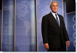 "President George W. Bush stands on stage at the Radisson Miami Hotel Friday, Oct. 12, 2007, in Miami, where he delivered remarks on trade policy. Speaking on free trade in the Americas, the President said, ""It's in the interests of the United States that prosperity spread through Latin America and South America."" White House photo by Eric Draper"