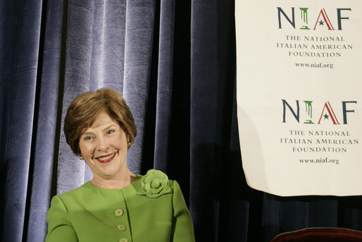 Mrs. Laura Bush smiles as she listens to an introduction by Dr. Ken Ciongoli , chairman of The National Italian American Foundation, during an education luncheon honoring Mrs. Bush with the NIAF Special Achievement Award in Literacy, Friday, Oct. 12, 2007 in Washington, D.C. In thanking the organization Mrs. Bush emphasized the many contributions that Italian-Americans have made in the education of our nation's youth. White House photo by Shealah Craighead
