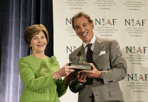 Mrs. Laura Bush is presented with The National Italian American Foundation's Special Achievement Award in Literacy from NIAF Chairman Dr. Ken Ciongoli, Friday, Oct. 12, 2007, in Washington, D.C. White House photo by Shealah Craighead