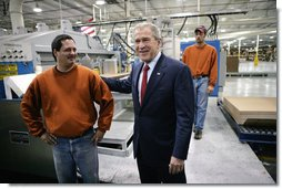 President George W. Bush meets with employees at Stribling Packaging Inc., Monday, Oct. 15, 2007 in Rogers, Ark., during a tour of the facility that specializes in the design of corrugated boxes and point-of-purchase displays. White House photo by Eric Draper