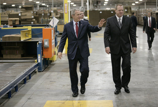 President George W. Bush tours the Stribling Packaging Inc., Monday, Oct. 15, 2007 in Rogers, Ark., with company President Bill Stribling. The facility specializes in the design of corrugated boxes and point-of-purchase displays. President Bush later met for lunch with local business leaders and delivered an address on fiscal responsibility. White House photo by Eric Draper
