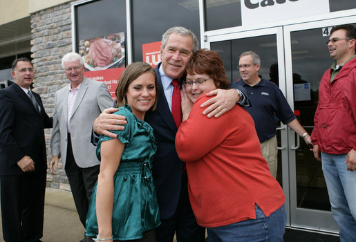 President George W. Bush is greeted outside the Whole Hog Cafe in Rogers, Ark., as he arrives for a lunch meeting with local business leaders Monday, Oct. 15, 2007. White House photo by Eric Draper