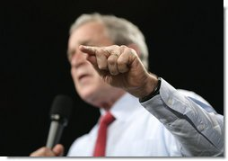 President George W. Bush gestures to make a point during his remarks to an audience at the John Q. Hammons Convention Center in Rogers, Ark., Monday, Oct. 15, 2007, urging Congress to be fiscally responsible with the taxpayer's money. White House photo by Eric Draper