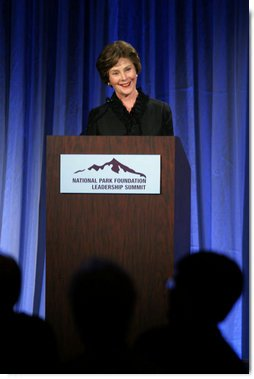 "Mrs. Laura Bush addresses the National Park Foundation's Leadership Summit on Partnership and Philanthropy Inaugural Founders Award Dinner Monday, Oct. 15, 2007, in Austin, Texas. ""Lady Bird Johnson wanted every American to experience the magic of our national parks. She made park preservation a priority of her husband's administration,"" said Mrs. Bush. ""She championed the National Historic Preservation Act, which President Johnson signed 41 years ago today. The Act launched the first coordinated federal effort to safeguard our country's heritage, and has led to four decades of terrific preservation work throughout the United States."" White House photo by Shealah Craighead"