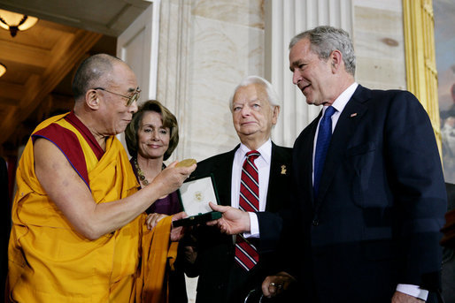 President George W. Bush, joined by U.S. Senator Robert Byrd and House Speaker Nancy Pelosi, presents the Congressional Gold Medal to The Dalai Lama at a ceremony Wednesday, Oct. 17, 2007 at the U.S. Capitol in Washington, D.C. White House photo by Chris Greenberg