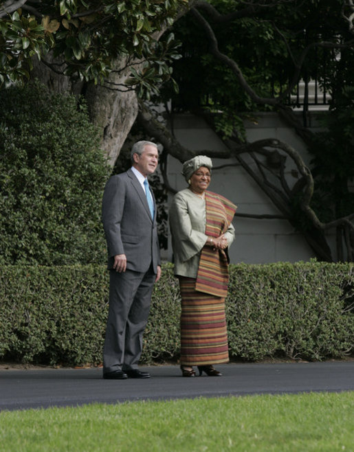 President George W. Bush shows President Ellen Johnson Sirleaf of the Republic of Liberia the view of the White House South Lawn and the monuments beyond, following their meeting Thursday, Oct. 18, 2007 in the Oval Office. President Sirleaf is Africa's first elected female head of state. White House photo by Joyce N. Boghosian