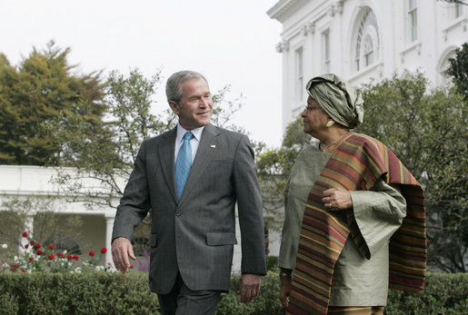 President George W. Bush speaks with President Ellen Johnson Sirleaf of the Republic of Liberia during a walk along the South Lawn driveway, Thursday, Oct. 18, 2007. White House photo by Joyce N. Boghosian