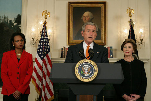 "Flanked by Secretary of State Condoleezza Rice and Mrs. Laura Bush, President George W. Bush delivers a statement at the White House Friday, Oct. 19, 2007, regarding sanctions on Burma. Said the President, ""The people of Burma are showing great courage in the face of immense repression. They are appealing for our help. We must not turn a deaf ear to their cries."" White House photo by Chris Greenberg"
